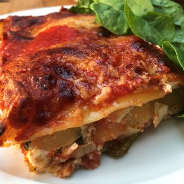 spianch and ricotta lasagna on plate green salad